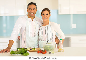 couple cooking healthy food - happy couple cooking healthy...