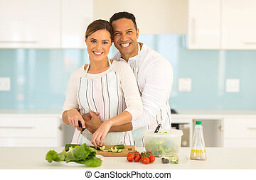 couple have fun in modern kitchen while preparing fresh...