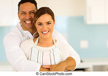 couple hugging in kitchen at home