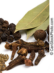 bay leafs, cloves and black pepper - cooking herbs. bay...