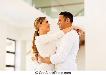couple embracing in an empty house