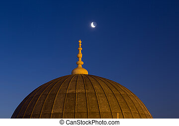 Suleymaniye Mosque dome in Istanbul and a new moon in the...