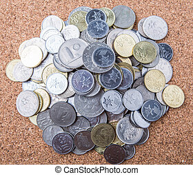 Malaysian Coins - Pile of Malaysian coins on cork board...