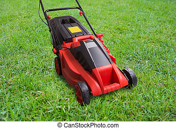lawn mower on green lawn