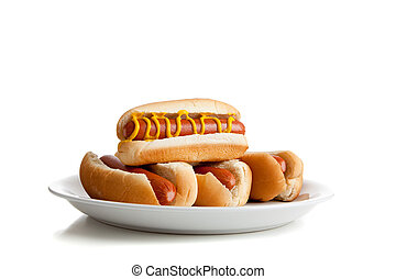 Stacked hot dogs with mustard and buns on white - Stacked...