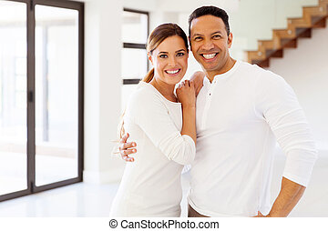 mid age couple portrait in their new house - beautiful mid...