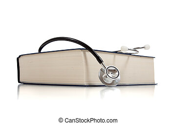 Medical reference book with a stethoscope on white