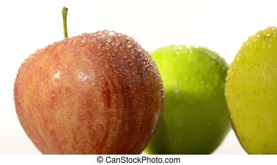 diverse apples - apples rotating over white background