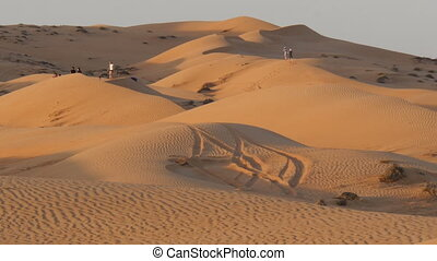 tourists in oman desert (Sharqiya Sand) known as wahiba...