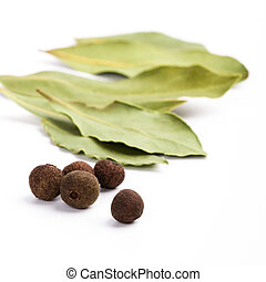 bay leafs and black pepper - cooking herbs. bay leafs and...