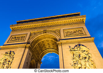 Evening view of Illuminated Arc de Triomphe in Paris