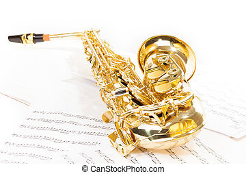 Alto saxophone laying on the musical notes - Beautiful...