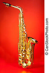 Alto saxophone in full length on red background - Alto...