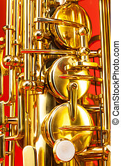 Close-up detailed view of alto saxophone keys on the red...