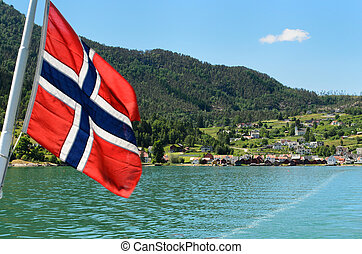 Car ferry in Norway - A Norwegian flag on the car ferry from...