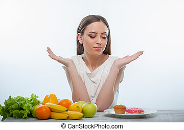 Pretty young woman wants to eat sweet food - Cheerful girl...