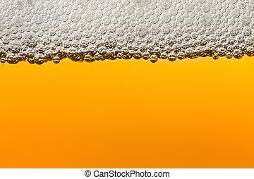 Beer with foam. Macro. - Beer with foam in transparent...