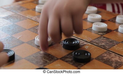 Children play checkers in classroom, HD