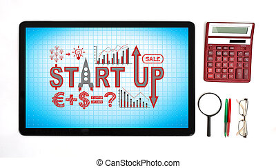 start up - touch pad with start up concept on workplace