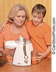 Woman and grandson in the kitchen