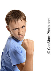 angry teenage boy - Portrait of an angry teenage boy on...
