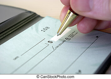 writting cheque 2 - close-up of fingers gripping pen while...