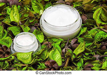 Organic skin care products Closeup of two open glass jars...