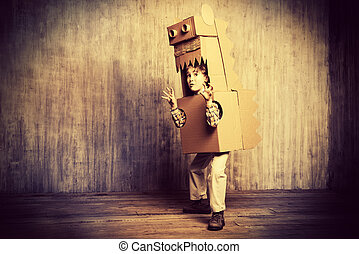 children horror - Funny dreamer boy playing with a cardboard...