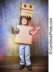 dragon - Little dreamer boy playing with a cardboard dragon,...