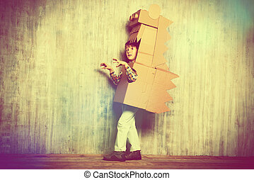 paper dinosaur - Little dreamer boy playing with a cardboard...
