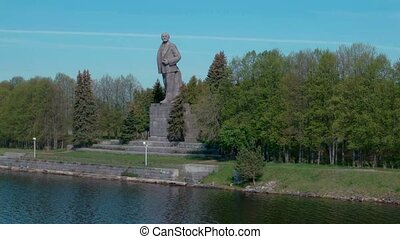 Giant Lenin monument on the shore on Moscow canal near...