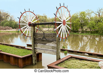 Sluice Gate - A vintage, manually operated wooden sluice...