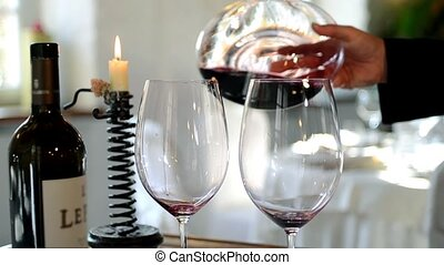 Sommelier pours wine into the decanter