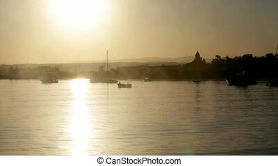 Algarve - Tavira Island - Sunset - Boats silhouette at...