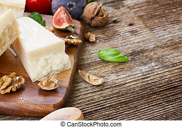 parmesan cheese on wooden table with copy space