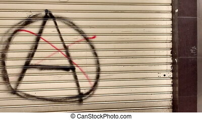 Roll Up Doorfront Sign Anarchy - Pan and zoom into anarchist...