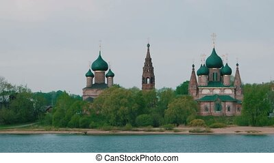 Orthodox Temples on river shore in Yaroslavl clear sky in...