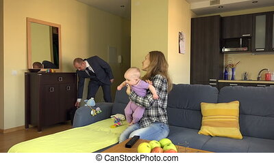 father pay nanny baby - businessman father return from work...