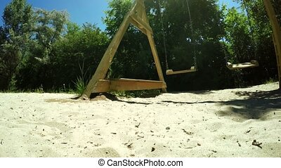 Wooden swing - On sand is Children wooden swing