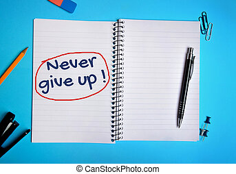 Never give up word writing on notebook