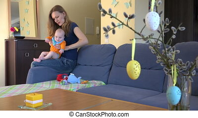 mother baby easter time - Happy blond mother exercise with...