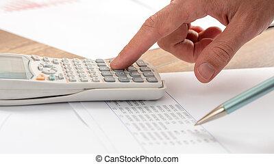Closeup of accountant doing a calculation