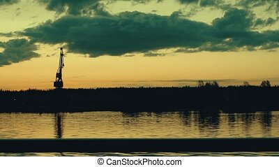 Morning on Volga river in the central Russia. Port Crane against colorful Sunrise Sky