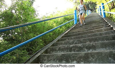 woman hiker climbing stairs at mountain peak