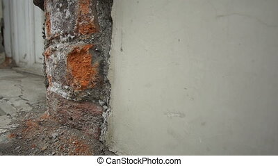 Colonial Building Rotten Bricks Pan - Panning shot of...