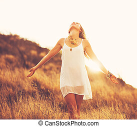 Happy Young Woman Outdoors at Susnet. Fashion Lifestyle.