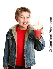 Happy healthy boy holding fresh fruit juice in clear cup - A...