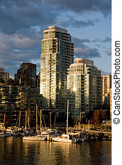 Condominium waterfront - Boats are docked at a marina on...