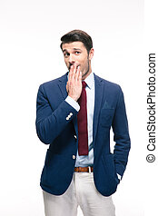 Businessman covering his mouth isolated on a white...
