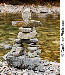 Creekside Inukshuk - An inukshuk constructed out of stones...